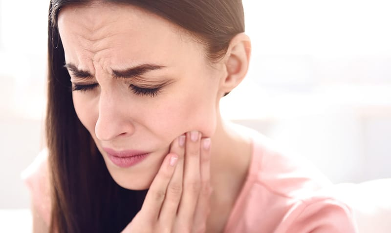 Woman with a bad tooth ache from grinding them
