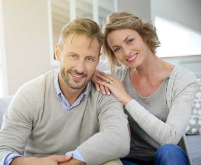 A happy couple thanks to their dental implants