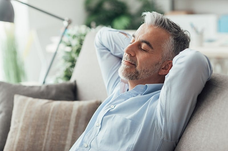 A businessman sleeping after using NuCalm, taking time for yourself helps reduce anxiety.