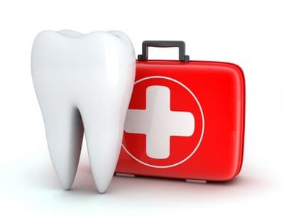 Large animated tooth next to a first aid kit